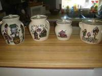 For sale is a canister set of 4 ceramic/crockery style
