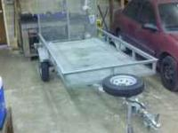Performance 4x8 utility trailer in good condition.