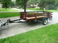 This 4'x8' trailer is about 6 months old with 3/4""