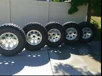 4 hardly worn Nitto trail grappler m/t tires. The spare