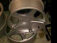I HAVE A SET OF 4 5.0 MUSTANG RIMS 17X8 5 LUG RIMS GRAY