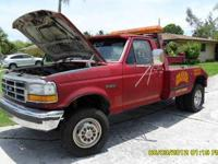 1989 FORD TOW TRUCK. This tow truck is in GREAT working