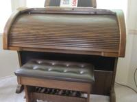 Selling a beautiful rolltop Lowery Rhapsody organ that