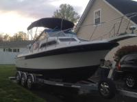 This is a Wellcraft Sportsman 250. The boat is a very