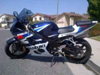 This ad is for a Blue/White 2004 Suzuki GSX-R 1000