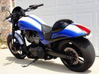 blue & white 2009 Victory Hammer S motorcycle. This
