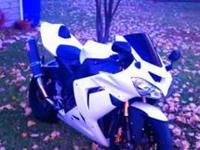 2005 Kawasaki ZX10r 15xxx miles flat white. It has