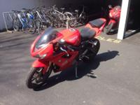 For sale is a red 2008 Triumph Daytona 675. Just over