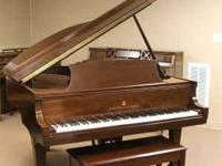 A beautiful Steinway Grand Piano and matching bench in