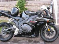 2007 HONDA CBR 1000rr FOR SALE HAS LOTS OF EXTRAS.