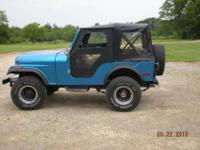 this is a 1977 jeep cj5 with a fiberglass body in great
