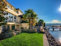 Premier waterfront estate on Lake Ave West with rare,