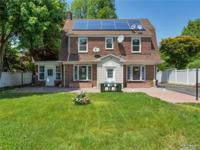 Charming Brick Dutch Colonial Set Back From The Road.
