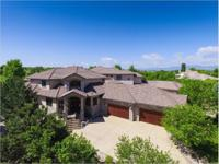 This amazing custom main floor master home in The Ranch