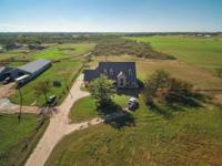Beautiful Farm house on just over 4 acres! Tons of