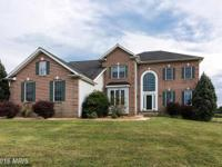 Welcome home to this open and inviting 5 bedroom brick