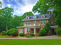 Price reduced! This majestic 1926 full brick home is