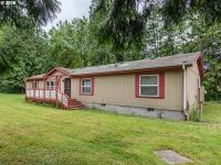 Easy 1 level living on affordable acreage! Spacious