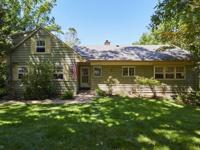 Situated on .75 acres, this home has charm, an amazing
