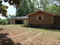 Great home on beautiful 38.08 acres with pond. Just