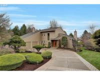 Updated throughout this custom NW contemporary is