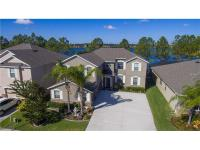 Stunning semi-custom home on a lake ! Featuring a great