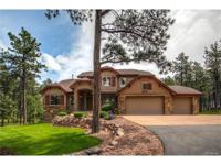 Surrounded by mature trees, this immaculate home on
