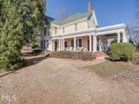 Stunning southern elegance is found upon this 1.89 acre