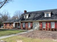 Stately 2 story brick colonial features 5 BRs (one