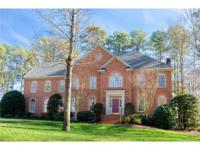 Beautiful, sunny, two-story brick colonial with a paved