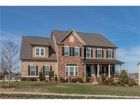 Gorgeous landscaping out front, hardwood floors &