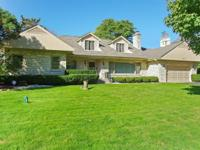 Superbly crafted all stone dormered ranch home in the