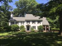 Classic 1920's center hall colonial nestled amongst