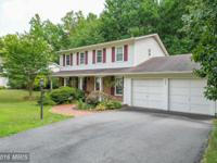 **super nice 3-level home on quiet wooded lot at the