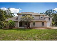 Lowest priced per square foot in seminole woods! Custom