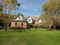 Prime wooded home site located on a quiet street in