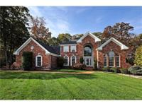 Located on a beautiful wooded lot, this spectacular 1.5