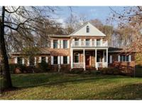 Wonderful 1.5 story situated on private wooded lot with