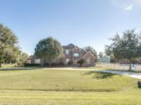 Gorgeous two story home sitting on over an acre of land
