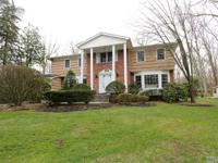 Updated Center Hall Colonial On An Acre Of Private