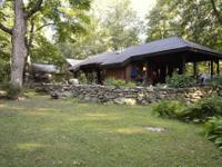 Idyllic setting is offered in this unique , lodge /