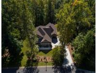 Stunning custom home on over two acres with privacy