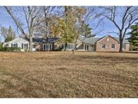 Here stands a majestic ranch home on 4.3 Acres offering