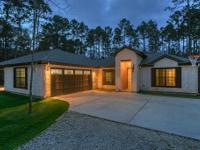 Custom Ranch home located in the Commons of Lake