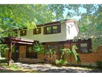Large Center Hall Colonial located in a very peaceful