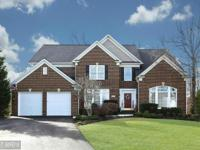 Stunning 2-story, 5ba, 6ba, brick front colonial, over