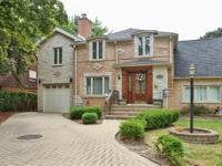 Beautiful two-story brick home featuring 5 bedrooms, 4