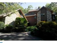 Stunning contemporary on 3 secluded wooded acres in