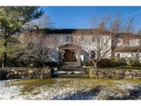 Milton Point colonial is a peaceful retreat set in a