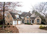 5 BR/5 BA, stone & stucco home in the heart of